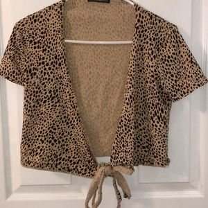 a cheetah print wrap top from brandy melville